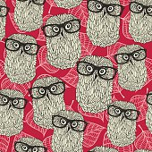 Seamless pattern with owls on the leaves background.