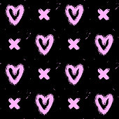 Seamless pattern with pink hand-drawn in ink messy hearts and crosses isolated on black background. Doodle style abstract grunge texture.