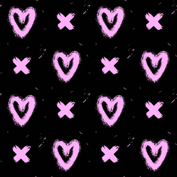 nahtlose muster mit rosa handgezeichneten in tinte chaotisch herzen und kreuze auf schwarzem hintergrund isoliert. doodle-stil abstrakt grunge texturen. - punk stock-grafiken, -clipart, -cartoons und -symbole