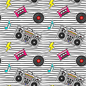 Seamless pattern with pop art stickers with tape recorder, cassette, vinyl record on modern texture with black stripes.