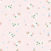Seamless pattern with small flowers on a beige background. Spring light airy texture. vector.