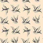 Seamless pattern with swallows in old school tattoo style. For poster, card, banner, flyer. Vector illustration