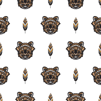 Seamless pattern with tiger head. Vector illustration.