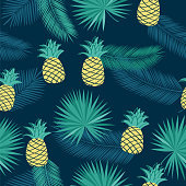 Seamless pattern with tropical leaves and pineapples for textile, wallpapers, gift wrap and scrapbook. Green background. Vector illustration.