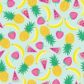 Seamless pattern with yellow bananas, pineapples and juicy strawberries.