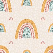 Seamless pattern with yellow rainbows. Background in hand drawn style for poster, fabric, wallpaper, textile, wrapping paper. Vector illustration