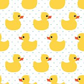 Seamless pattern with yellow rubber duck on polka dots background