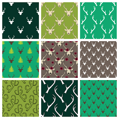 Seamless patterns set with deer heads and antlers