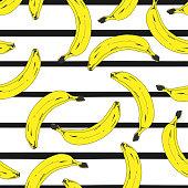 Seamless pop art yellow banana pattern randomly distributed on stripped background. Vector Illustration.