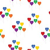 Vector seamless pattern of multi-colored heart shaped balloons on a white background.