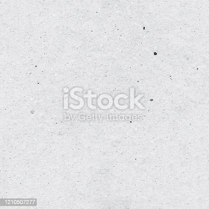 istock Seamless recycled flat gray paper background - a flat sheet of paper with a pronounced texture with visible pollution and roughness of handmade paper - original vector illustration 1210507277