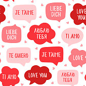 Seamless pattern of red speech bubbles. Love you in different languages. Vector illustration for Valentine's day