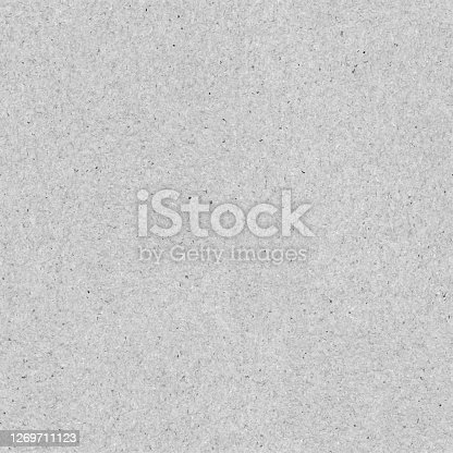 istock Seamless smooth polluted gray recycled handmade paper - concrete tile in vector with visible components - paper background full of dots spots discolorations - raw and harsh structure 1269711123