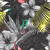 A gorgeous seamless tropical pattern with a bright amorphous shape background.