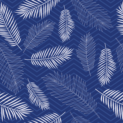 Seamless tropics background. Tropical leaves on a background of zigzag lines in blue