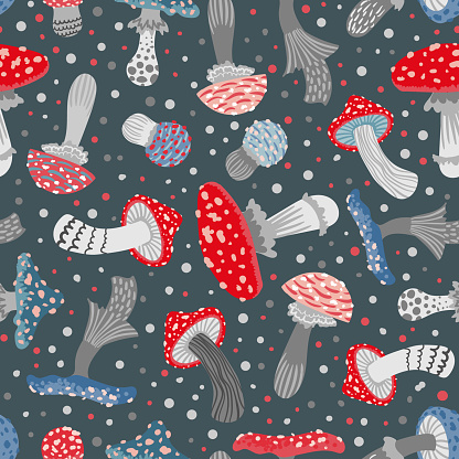 Seamless vector pattern of stylized fly agarics on a dark gray background