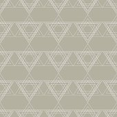 Seamless vector pattern. Symmetrical geometric background with grey triangles in the shape of stars. Decorative repeating ornament.