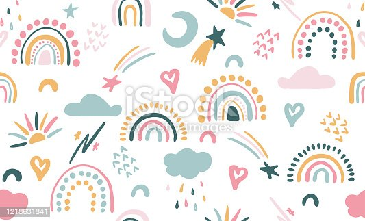 istock Seamless vector pattern with hand drawn rainbows and sun. Trendy baby texture 1218631841