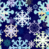 Seamless winter background with stylized snowflakes in different colors on a white background.