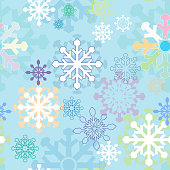 Seamless winter background with stylized snowflakes made ​​in different colors on a blue background