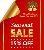 Seasonal sale of fifteen percent on a luxury golden and red curled paper with Christmas wishes and decoration.