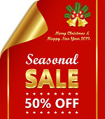 Seasonal sale of fifty percent on a luxury golden and red curled paper with Christmas wishes and decoration.
