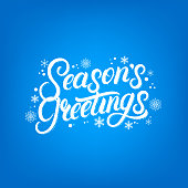 Seasons Greetings hand written lettering design. Modern brush calligarphy for Christmas card.