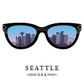Seattle city skyline silhouette reflected in the glasses.