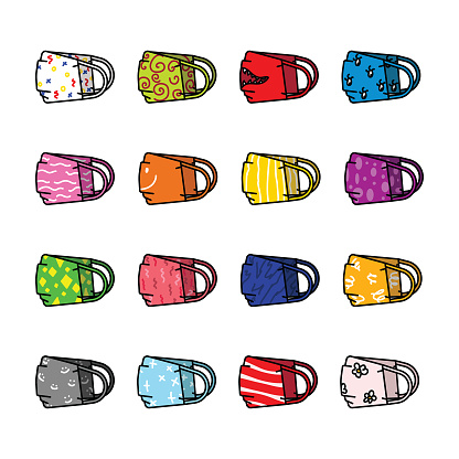 Selection of 16 hand made face masks with colorful pattern.