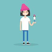 Self presentation. Young female character holding her 3D model on the palm / flat editable vector illustration, clip art