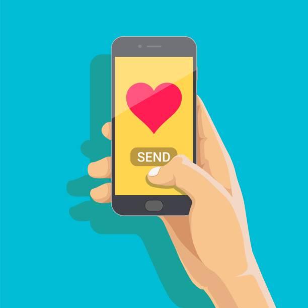 wysyłanie koncepcji wiadomości miłosnych. trzymając telefon ręką z sercem, wyślij przycisk na ekranie. ekran dotykowy palcem. wektor płaska ilustracja kreskówki do reklamy, stron internetowych, banerów, projektowania infografik - ręka człowieka stock illustrations