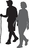 Vector silhouette of a senior couple walking side by side together.