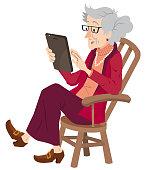 Senior Lady using Digital Tablet