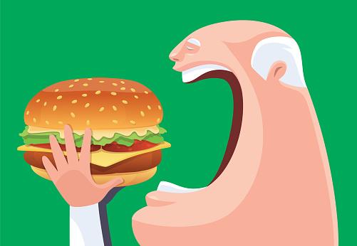 senior man eating big hamburger