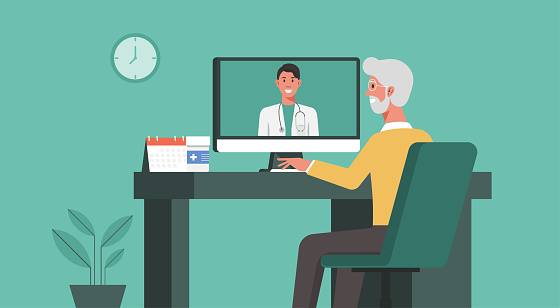 senior man using computer video call conferencing to doctor online