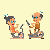 Senior people doing exercise with exercise bike and elliptical machines