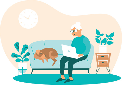 Senior Woman at home with Laptop in Hands