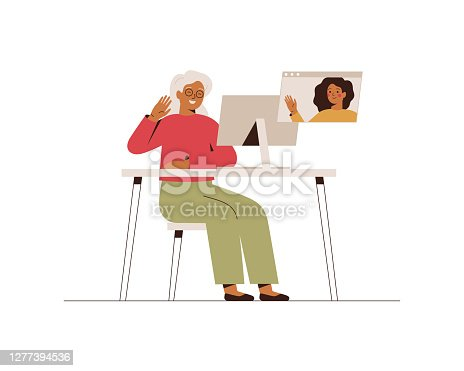 istock Senior woman has a video call with her adult daughter. Happy grandmother makes online conversation with her grandchild at the computer. 1277394536