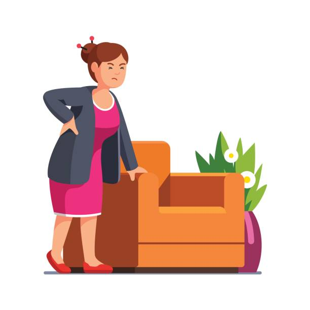 Senior woman holding her back suffering from pain Senior woman standing frowned with closed eyes leaning on arm chair holding back suffering from pain. Lady experiencing backache at home. Flat style vector illustration isolated on white background. backache stock illustrations
