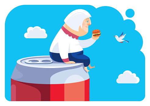 senior woman sitting on big soda can and holding hamburger