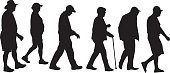 Vector silhouettes of six senior men and women walking.