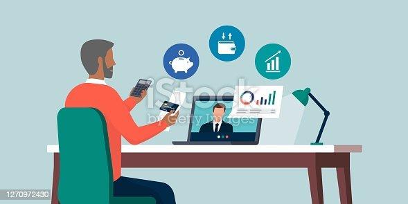 istock Senor man videocalling his financial consultant online 1270972430