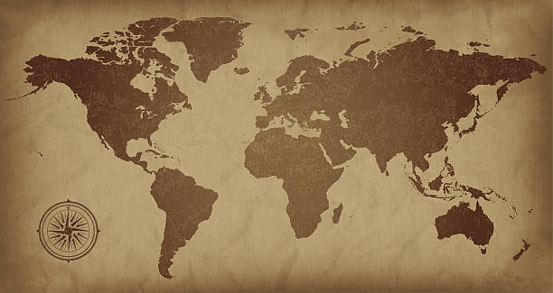 A sepia colored vintage world map, with a compass detail  A world map on aged paper. Files included – jpg, ai (version 8 and CS3), svg, and eps (version 8) obsolete stock illustrations