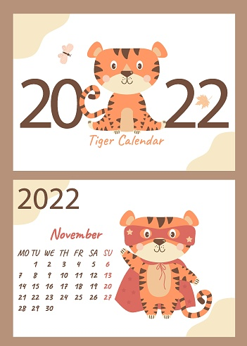 Set 2022 calendar - November  and cover. Cute tiger wizard in a mask and a red cloak. horizontal A4 template. Week starts on Monday. Year of the Tiger in Chinese or oriental