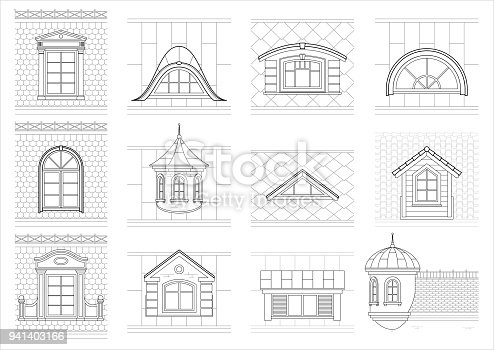 A set of classic mansard facade windows. Pediments. Attics. Silhouettes of city roofs