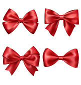 Set Collection of Festive Red Satin Bows Isolated on White