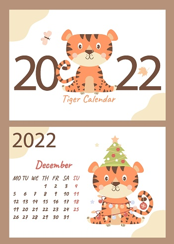 Set - December 2022 calendar and cover. Cute tiger cub with a Christmas tree, toys and garlands. horizontal A4 template. Week starts on Monday.  Year of the Tiger in Chinese or oriental