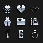 istock Set Envelope with Valentine heart, Please do not disturb, Wedding rings, Calendar February 14, Key shape, cake, Heart shaped love glasses and on hand icon. Vector 1334148438
