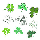 Set hand-drawn leaf clover in green colors. Three and Four leaf, silhouettes, doodle, stylized. St. Patrick's day