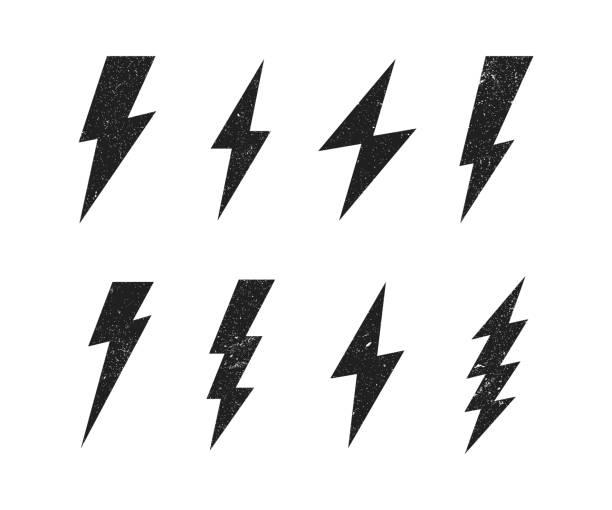 illustrazioni stock, clip art, cartoni animati e icone di tendenza di set lightning bolt with grunge texture. thunderbolt, lightning strike. modern flat style vector illustration - fulmine